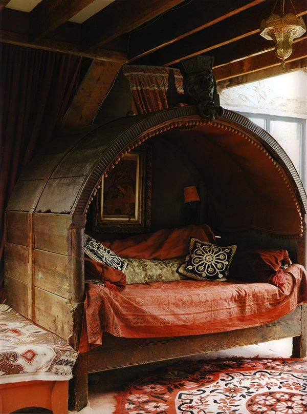 Interesting bedroom in wooden Bohemian style