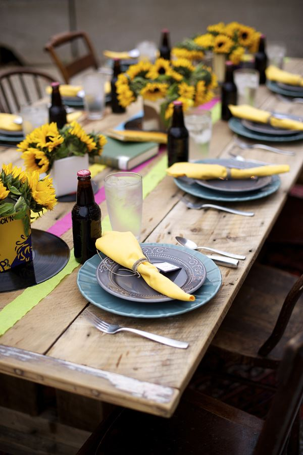 Design of dining table decorated with yellow flowers