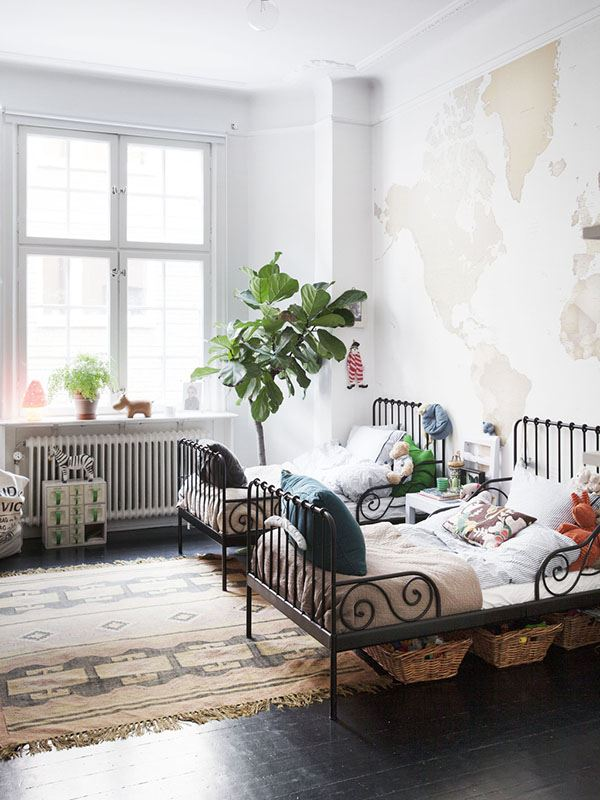 children's room with wrought iron beds for two brothers